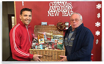 Christmas Hamper winner Mr Ron Gibson and Stephen Wyss Homestead Caravans Accessory Showroom Manager