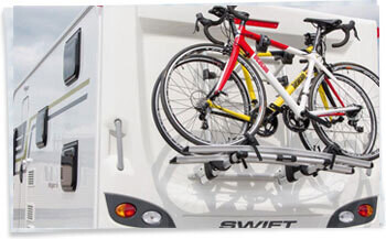 2 Bikes mounted to a Thule Cycle carrier on the rear wall of a Swift touring caravan